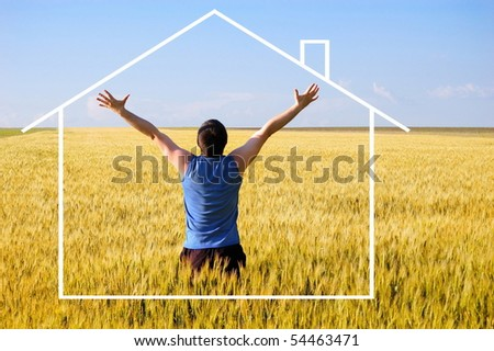 The guy in an autumn field. Has lifted hands upwards