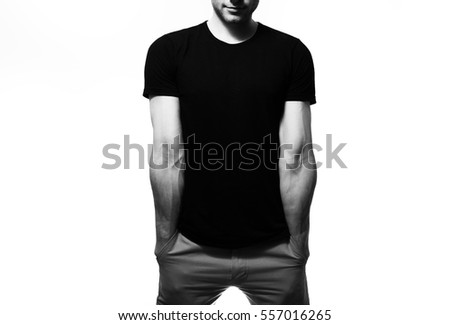 the guy in the blank black t-shirt, stand,  smiling on a white background, mock up, free space, logo, design, template for design print,  #557016265