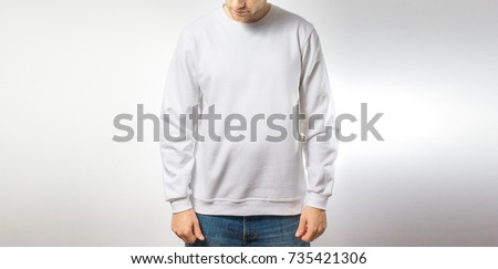 the guy in the blank white sweatshirt, stand,  smiling on a white background, mock up, free space, logo, design, template for design print