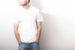 the guy in the blank white t-shirt, stand,  smiling on a white background, mock up, free space, logo, design, template for design print