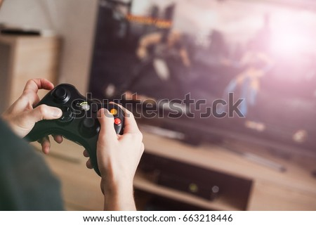 Photo of  The guy is playing on the console