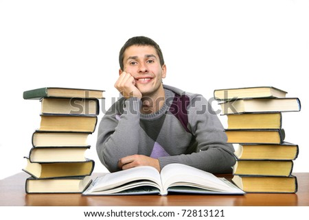 the guy is sitting among the books