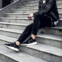 the guy is sitting on the stairs. Hype. Fashion wallpaper. Hype sneaker. Men