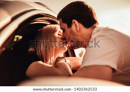 the guy kisses the girl who is driving #1402362533