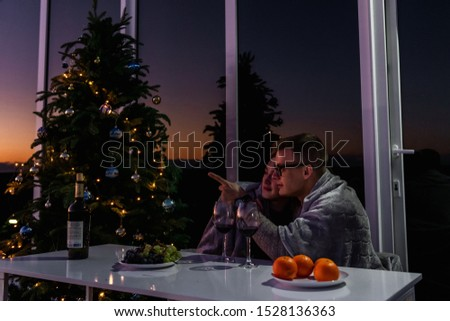 The guy with the girl celebrate the new year. Young couple celebrates christmas. #1528136363
