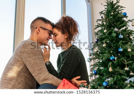The guy with the girl celebrate the new year. Young couple celebrates christmas. #1528136375