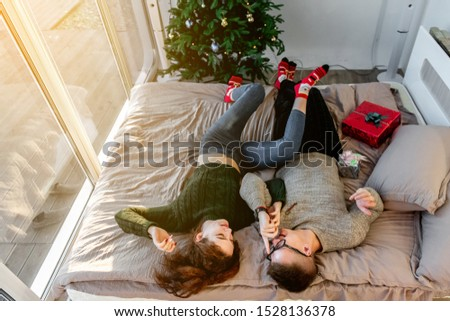 The guy with the girl celebrate the new year. Young couple celebrates christmas. #1528136378