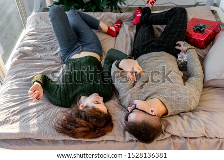 The guy with the girl celebrate the new year. Young couple celebrates christmas. #1528136381