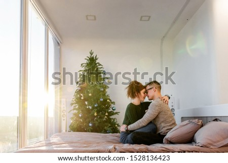 The guy with the girl celebrate the new year. Young couple celebrates christmas. #1528136423