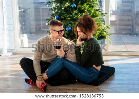 The guy with the girl celebrate the new year. Young couple celebrates christmas. #1528136753
