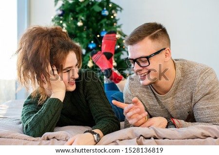 The guy with the girl celebrate the new year. Young couple celebrates christmas. #1528136819
