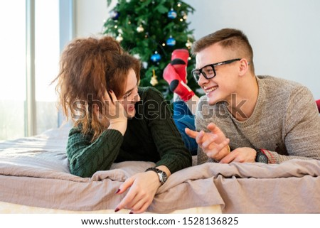 The guy with the girl celebrate the new year. Young couple celebrates christmas. #1528136825