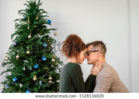 The guy with the girl celebrate the new year. Young couple celebrates christmas. #1528136828