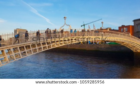 The Ha Penny Bridge or Half Penny Bridge in Dublin - DUBLIN / IRELAND - MARCH 20, 2018 #1059285956