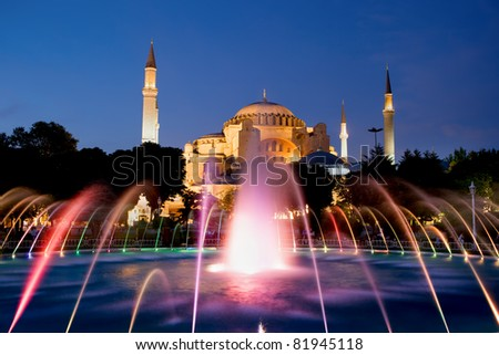 The Hagia Sophia Byzantine architecture and fountain illuminated at dusk, famous historic landmark and world wonder in Istanbul, Turkey