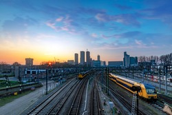 The Hague (Den Haag in Dutch) skyline during the sunset moment behind the train station