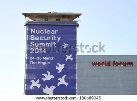 THE HAGUE, HOLLAND - MARCH 9, 2014: Large banner on a building, next to the world forum congress center, announcing the Nuclear Security Summit 2014 in The Hague, Holland on March 9, 2014