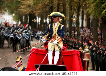 THE HAGUE, HOLLAND - SEPT 20: Driver of  Coach with royal family on Prinsjesdag (opening of parliamentary year by Queen) on September 20, 2011 in The Hague, Holland. - stock photo