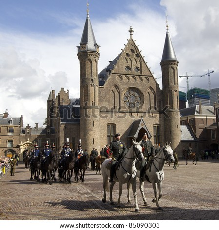 THE HAGUE, HOLLAND - SEPTEMBER 18: Horsemen ride at a military ceremony on the courtyard of the Binnenhof on September 18, 2011 in The Hague, Holland, The Binnenhof is the site of the Dutch parliament