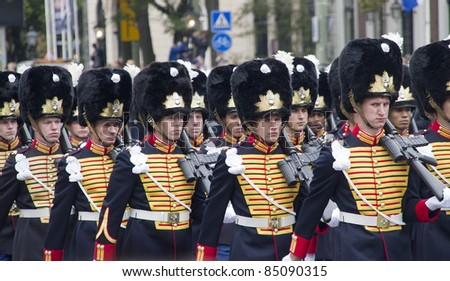 THE HAGUE, HOLLAND - SEPTEMBER 19: Uniformed soldiers parade on Prinsjesdag in The Hague, Holland on September 19, 2010. Prinsjesdag is the annual presentation of Government Policy to Parliament - stock photo