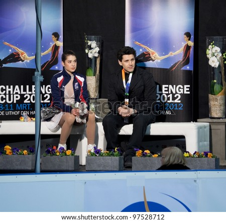 THE HAGUE - MAR 10: American figure skater Alissa Czisny sits in the kiss and cry with coach Jason Dungjen awaiting her marks at the Challenge Cup, on March 10, 2012 in The Hague, the Netherlands