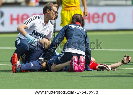 THE HAGUE, NETHERLANDS - JUNE 2: Doctors tend to injured England player Ashley Jackson during the Rabobank World Cup Hockey 2014 in the match against India. GBR beats IND with 2-1