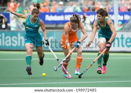 THE HAGUE, NETHERLANDS - JUNE 14: Dutch player Lidewij Welten breaks through the Australian Defence at the finals of the Rabobank Hockey World Cup. NED - AUS 2-0 in 2014