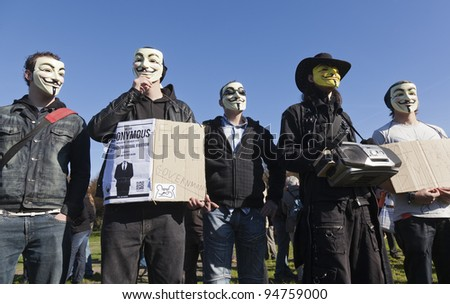 THE HAGUE – OCTOBER 15: Five masked members of Anonymous protesting during the Occupy protest on October 15, 2011 in The Hague, The Netherlands.