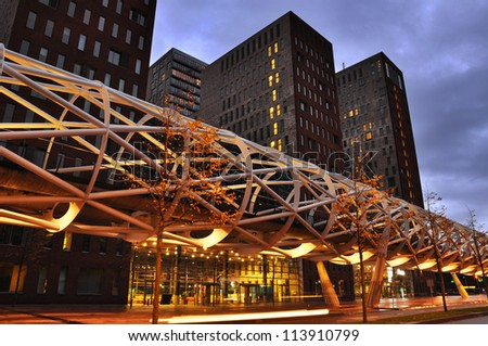 The Hague, The Netherlands, a modern tram viaduct calling: The 'Netkous' or Fishnet Stocking, in The Beatrixkwartier, a modern financial district in Den Haag, Holland