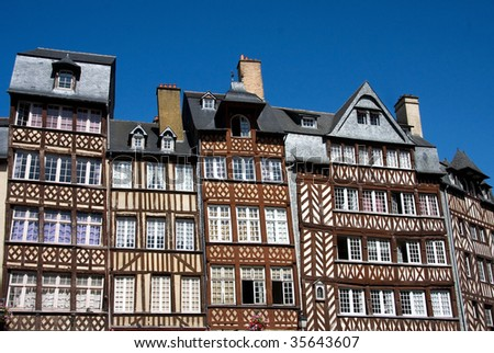 The half-timbered buildings of historic Rennes, Brittany, Northern France, against clear blue sky