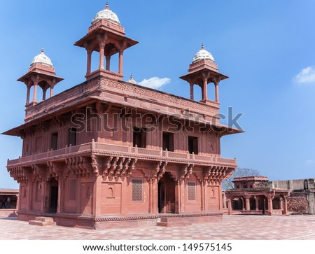 The Hall of Private Audience at Fatehpur Sikri palace and fort near India's Agra. Two story palace in red sandstone and white domes against blue skies.