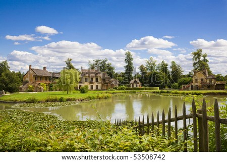 stock-photo-the-hamlet-houses-behind-the-pond-of-marie-antoinette-s