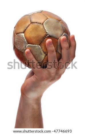 The hand holds a ball on a white background