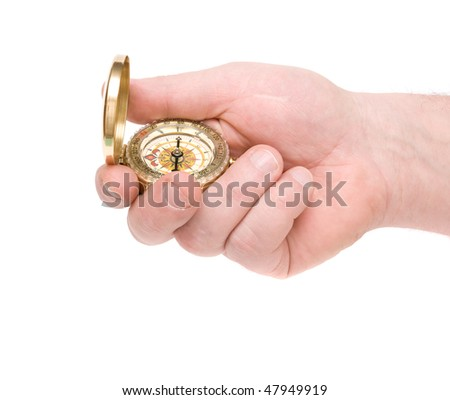 The hand holds compass on white background - stock photo