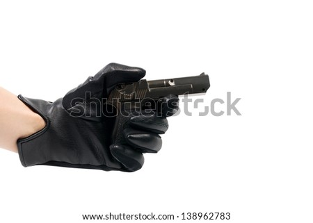 The hand in a black glove with a gun, isolated on white background