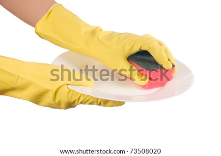 The hand in a glove washes a plate