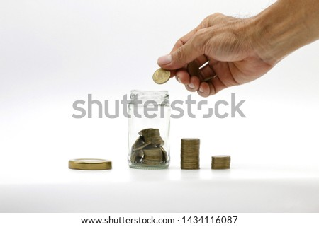 The hand is coin saving,saving in the saving box on white background with copy space. #1434116087