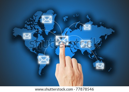 The hand is pressing on the letter - stock photo