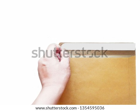 The hand is stripping the adhesive strip on the envelope.on white colour background #1354595036