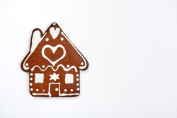 The hand-made eatable gingerbread house on white background
