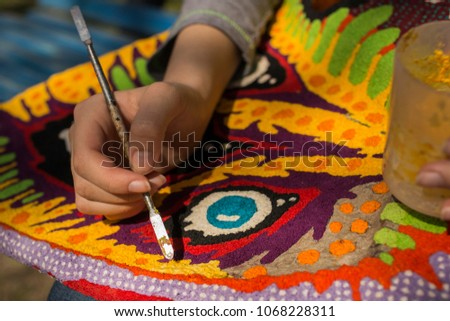 The hand of the artist. Work with a sharp tool. The execution of the decorative sculpture made of paper. #1068228311