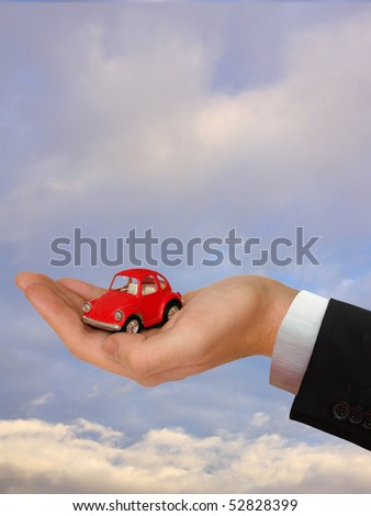 The Hand of the Businessman with the lovely red Car