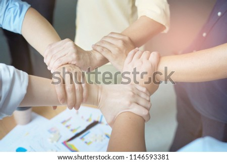 The hand on hand of the successful teamwork and business partnership concept #1146593381