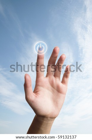 the hand presses the button
