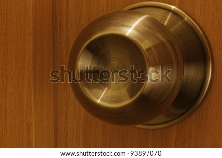 The handle on wooden door