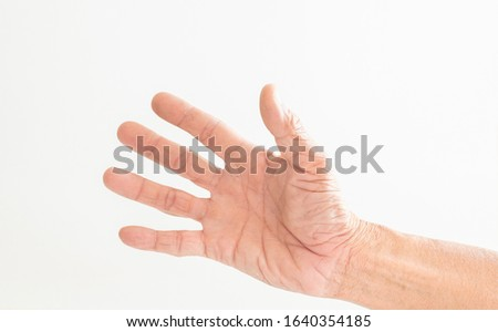 The hands and fingers of the elderly gestures shown on a white background Stock photo ©