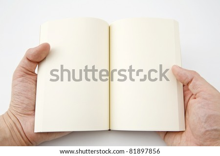 The hands holding a blank book