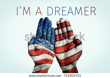the hands of a man put together patterned as the flag of the United States and the text I am a dreamer, for the beneficiaries of the Dream Act, on a pale blue background