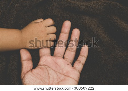 The hands of children and parents.