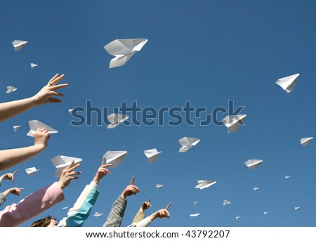 The hands of children throw upwards messages in the manner of paper airplanes.